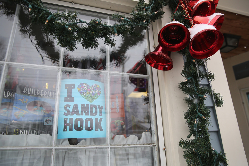 . Christmas decorations adorn a business near the former site of Sandy Hook Elementary on December 14, 2012 in Newtown, Connecticut. One year ago Adam Lanza shot and killed 20 first graders and six adults at the school. Newtown decided not to hold a public memorial on the anniversary out of respect for victims\' survivors, and the town appealed for privacy.  (Photo by John Moore/Getty Images)