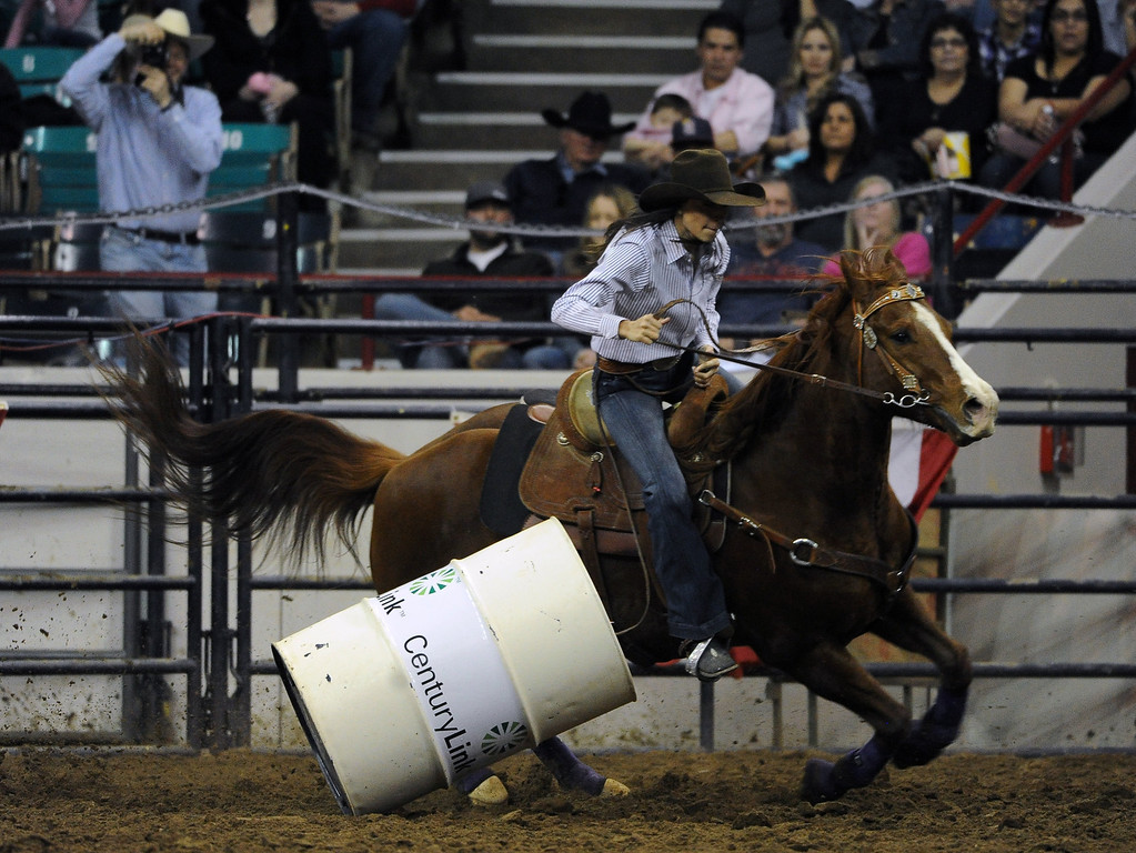 . DENVER, CO- JANUARY 27:  Deena Moeykens of Three Forks, Montana hits a barrel during the barrel race.  The final day of the 2013 National Western Stock show was Sunday, January 27th.  One of the big events for the day was the PRCA Pro Rodeo finals in the Coliseum.  The event featured bareback riding, steer wrestling, team roping, saddle bronc riding, tie down roping, barrel racing and bull riding.  (Photo By Helen H. Richardson/ The Denver Post)