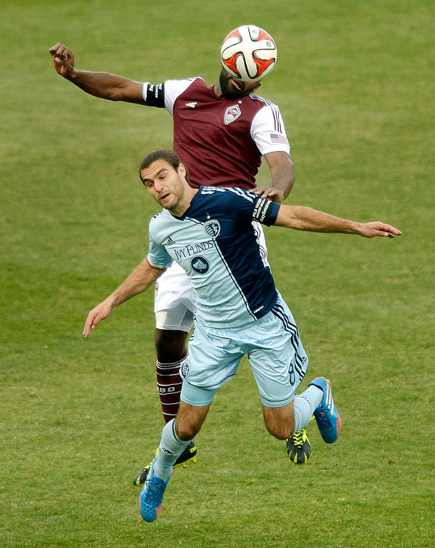 . Colorado defenseman Marvell Wynne (22) challenged Kansas City forward Graham Zusi (8) for a header in the second half. Sporting Kansas City defeated the Colorado Rapids 3-2 Saturday evening, March 29, 2014 at Dick\'s Sporting Goods Stadium in Commerce City.  (Photo by Karl Gehring/The Denver Post)