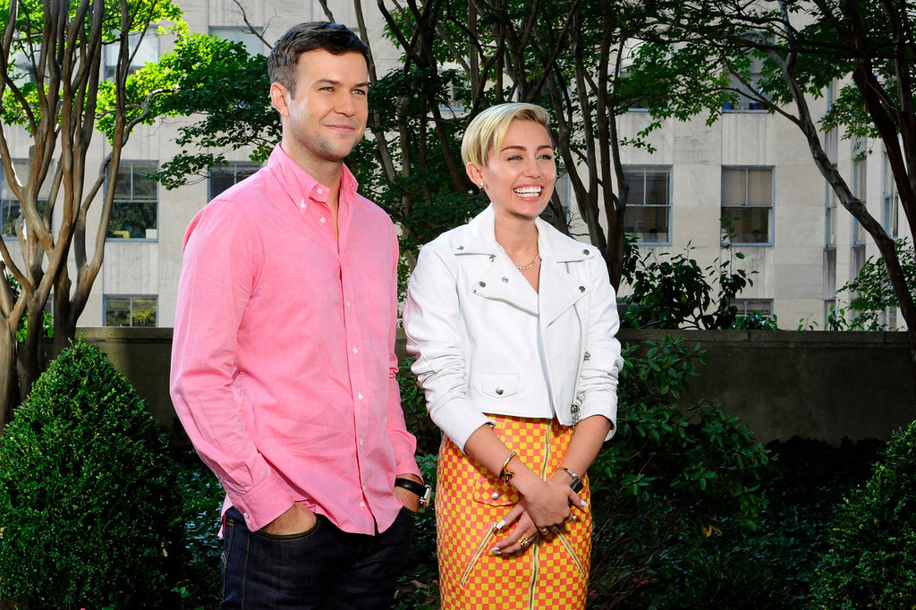 """. SNL cast member Taran Killam, left, and actress-singer Miley Cyrus during a promo for the upcoming \""""Saturday Night Live,\"""" in New York on Oct. 1, 2013. Cyrus hosted and performed on the late night sketch comedy series on Oct. 5, 2013.  (AP Photo/NBC, Dana Edelson)"""