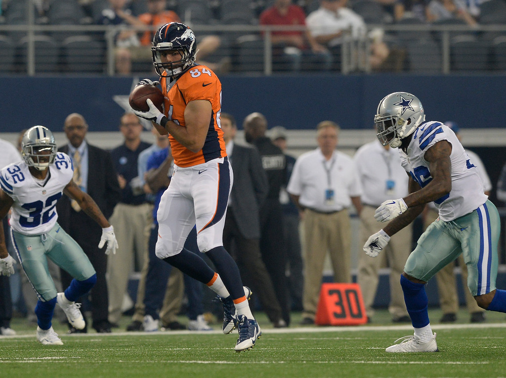 . ARLINGTON, TX - AUGUST 28: Denver Broncos tight end Jacob Tamme (84) catches a pass during the first quarter in front of Dallas Cowboys safety Ahmad Dixon (36) August 28, 2014 at AT&T Stadium. (Photo by John Leyba/The Denver Post)