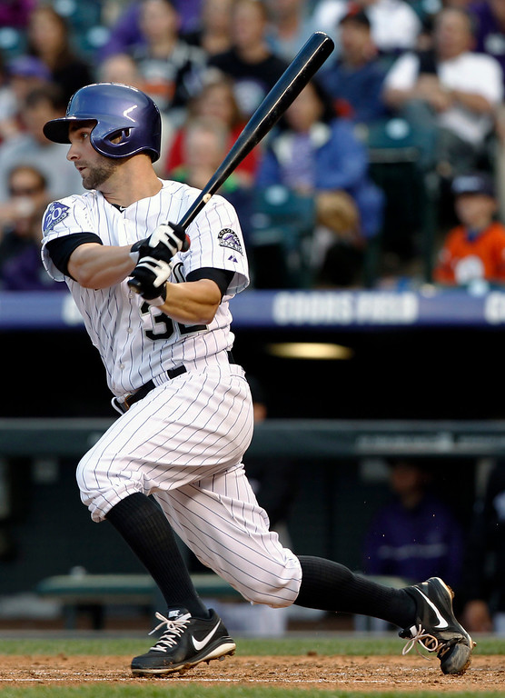 . Colorado Rockies\' Tyler Chatwood follows the flight of his RBI-single against the San Francisco Giants in the fourth inning of a baseball game in Denver, Saturday, May 18, 2013. (AP Photo/David Zalubowski)