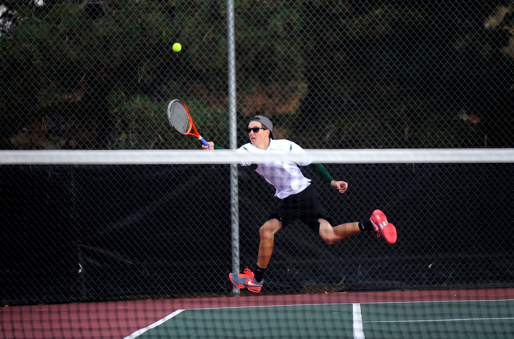 . DENVER, CO. - OCT 12:   Fossil Ridge player Trevor Swambom dives for the ball during a doubles match against Regis Jesuit players.   (Photo By Erin Hull/The Denver Post)