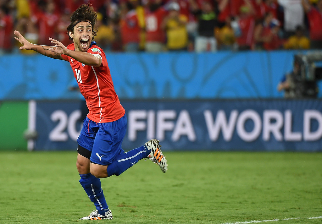 . Chile\'s forward Jorge Valdivia celebrates after scoring during a Group B football match between Chile and Australia at the Pantanal Arena in Cuiaba during the 2014 FIFA World Cup on June 13, 2014. WILLIAM WEST/AFP/Getty Images
