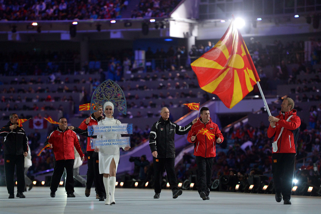 . Macedonia\'s flag bearer, cross-country skier Darko Damjanovski, leads his national delegation during the Opening Ceremony of the 2014 Sochi Winter Olympics at the Fisht Olympic Stadium on February 7, 2014 in Sochi. AFP PHOTO / ALBERTO PIZZOLI/AFP/Getty Images