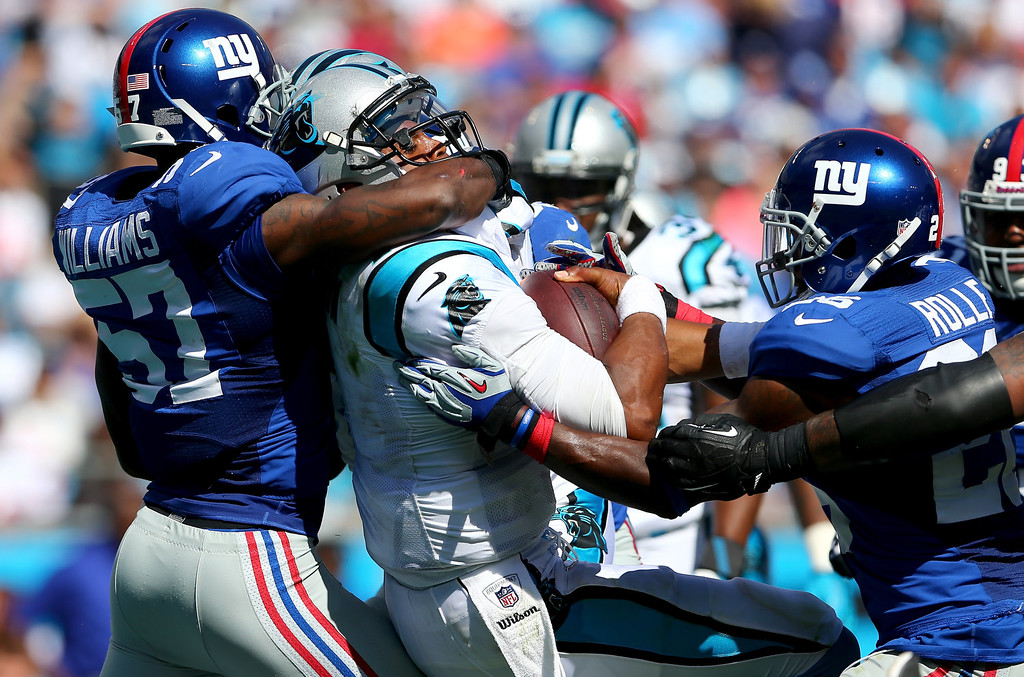 . Cam Newton #1 of the Carolina Panthers runs for a touchdown past Jacquian Williams #57 of the New York Giants during their game at Bank of America Stadium on September 22, 2013 in Charlotte, North Carolina.  (Photo by Streeter Lecka/Getty Images)