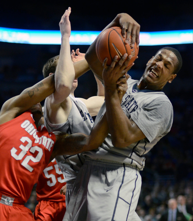 . Penn State\'s Jordan Dickerson, right, grabs a rebound during the first half of an NCAA college basketball game on Thursday, Feb. 27, 2014, in State College, Pa. (AP Photo/Ralph Wilson)