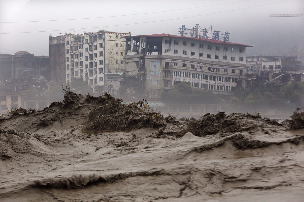 . Heavy flood waters sweep through Beichuan in southwest China\'s Sichuan province on July 9, 2013. Rainstorms across parts of China have affected millions, causing landslides and disabling transportation in provinces such as Sichuan and Yunnan, state media reported.  AFP/Getty Images