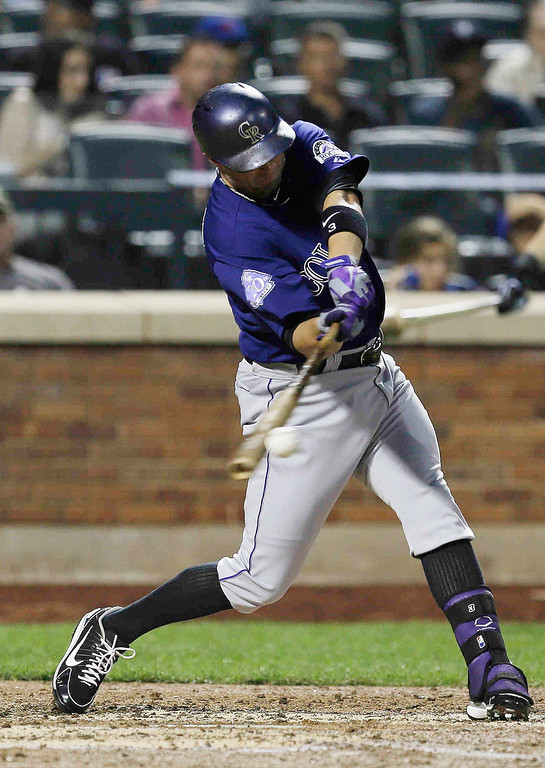 . Colorado Rockies\' Michael Cuddyer hits a single during the fourth inning of a baseball game against the New York Mets on Wednesday, Aug. 7, 2013, in New York.(AP Photo/Frank Franklin II)