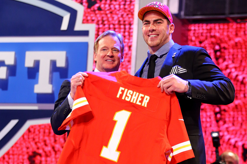 . Eric Fisher (R) of Central Michigan University stands on stage with NFL COmmissioner Roger Goodell after Fisher was picked #1 overall by the Kansas City Chiefs in the first round of the 2013 NFL Draft at Radio City Music Hall on April 25, 2013 in New York City.  (Photo by Al Bello/Getty Images)