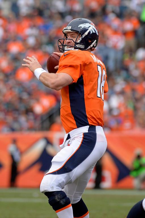 . Denver Broncos quarterback Peyton Manning (18) throws during the third quarter.  (Photo by Joe Amon/The Denver Post)