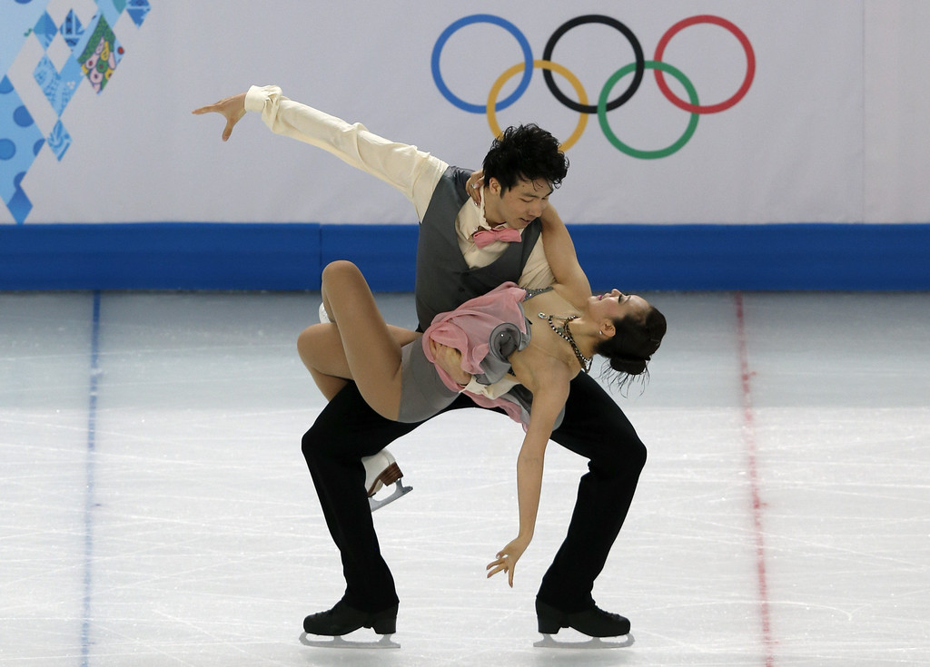 . China\'s Huang Xintong and Zheng Xun perform in the Figure Skating Ice Dance Short Dance at the Iceberg Skating Palace during the Sochi Winter Olympics on February 16, 2014.   ADRIAN DENNIS/AFP/Getty Images