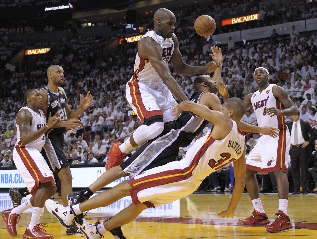 . Tony Parker (C) of the San Antonio Spurs takes a tumble before  Joel Anthony (center-top) and Shane Battier (R) of the Miami Heat in the first half during Game 1 of the NBA Finals on June 6, 2013 at American Airlines Arena in Miami, Florida.   BRENDAN SMIALOWSKI/AFP/Getty Images