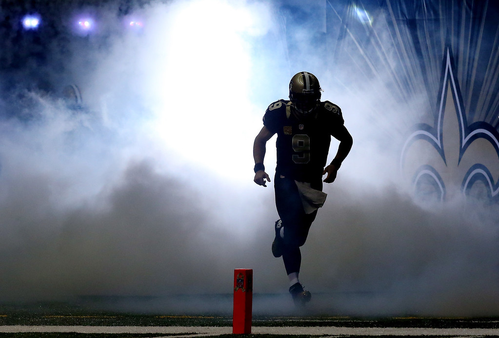 . Quarterback Drew Brees #9 of the New Orleans Saints takes the field before a game against the Dallas Cowboys at the Mercedes-Benz Superdome on November 10, 2013 in New Orleans, Louisiana.  (Photo by Ronald Martinez/Getty Images)