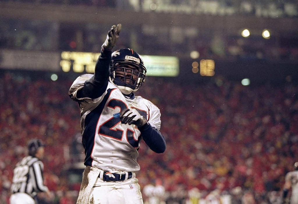 . Defensive back Darrien Gordon of the Denver Broncos celebrates during a playoff game against the Kansas City Chiefs at Arrowhead Stadium in Kansas City, Missouri, January 4, 1998.  The Broncos won the game, 14-10.  Andy Lyons/Allsport