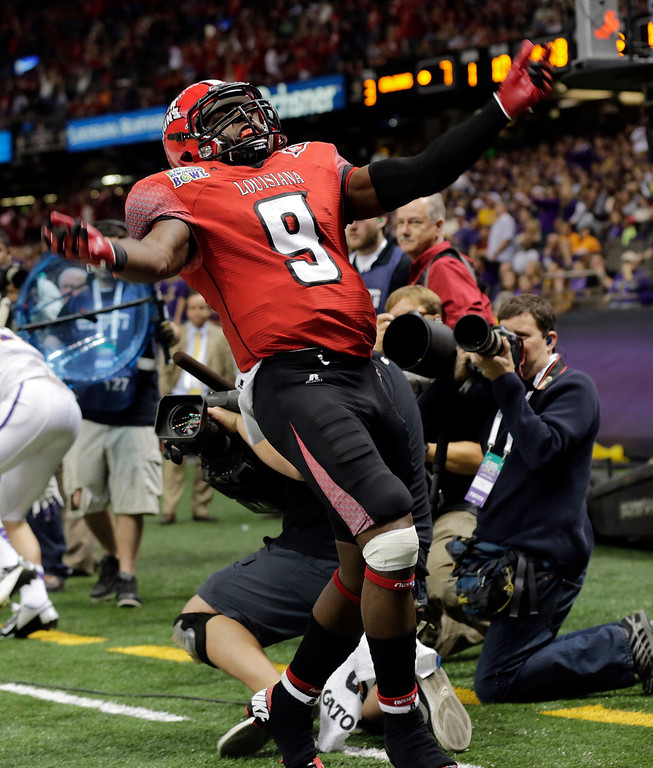 . Louisiana-Lafayette wide receiver Harry Peoples (9) reacts after scoring against East Carolina in the first half of the New Orleans Bowl, an NCAA college football game in New Orleans, Saturday, Dec. 22, 2012. (AP Photo/Dave Martin)