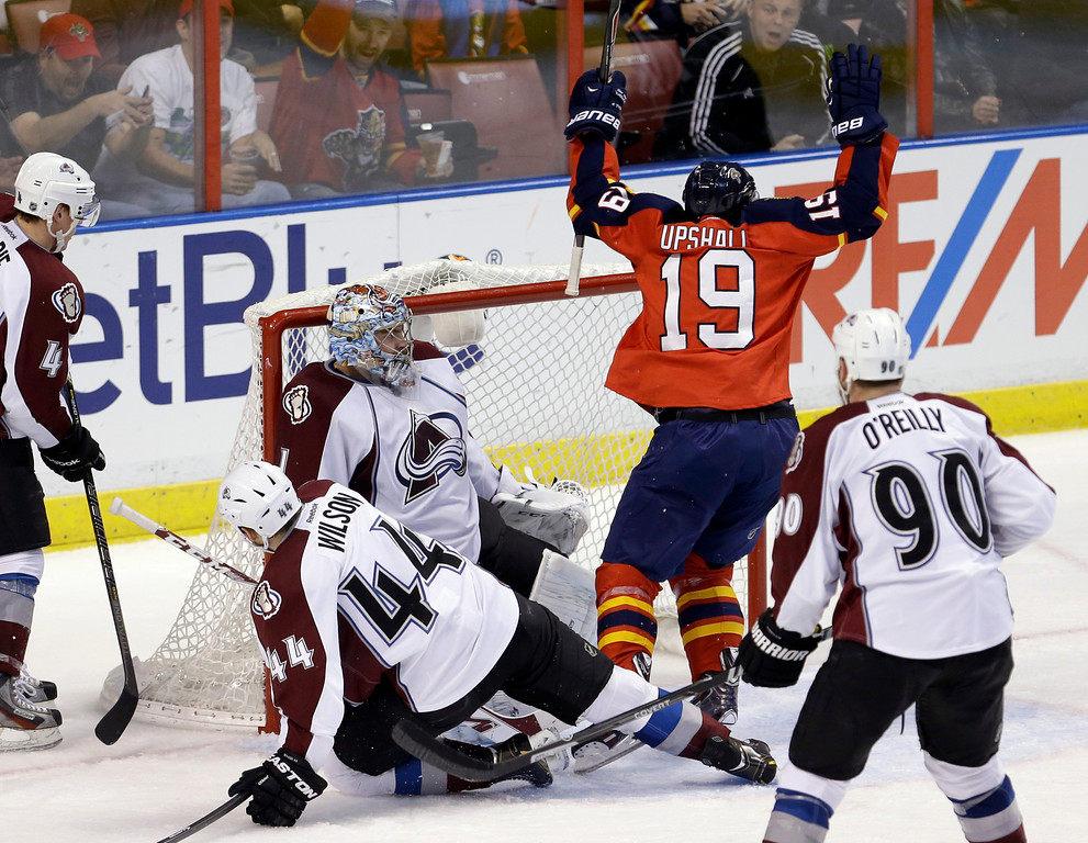 . Florida Panthers right wing Scottie Upshall (19) celebrates after scoring against the Colorado Avalanche during the third period of an NHL hockey game in Sunrise, Fla., Friday, Jan. 24, 2014. The Avalanche won 3-2. (AP Photo/Alan Diaz)