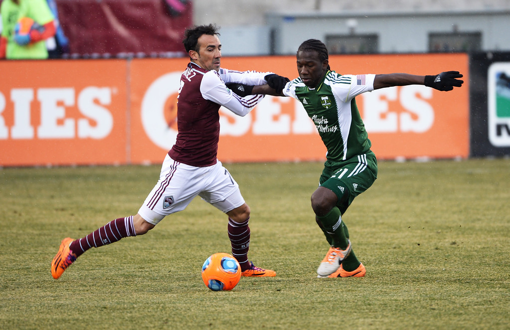 . COMMERCE CITY MARCH 22: Vincente Sanchez of Colorado Rapids (7), left, and Diego Chara of Portland Timbers (21) fight for a free ball in the 1st half of the game at Dick\'s Sporting Goods Park. Commerce City, Colorado. March 22. 2014. Colorado won 2-0. (Photo by Hyoung Chang/The Denver Post)