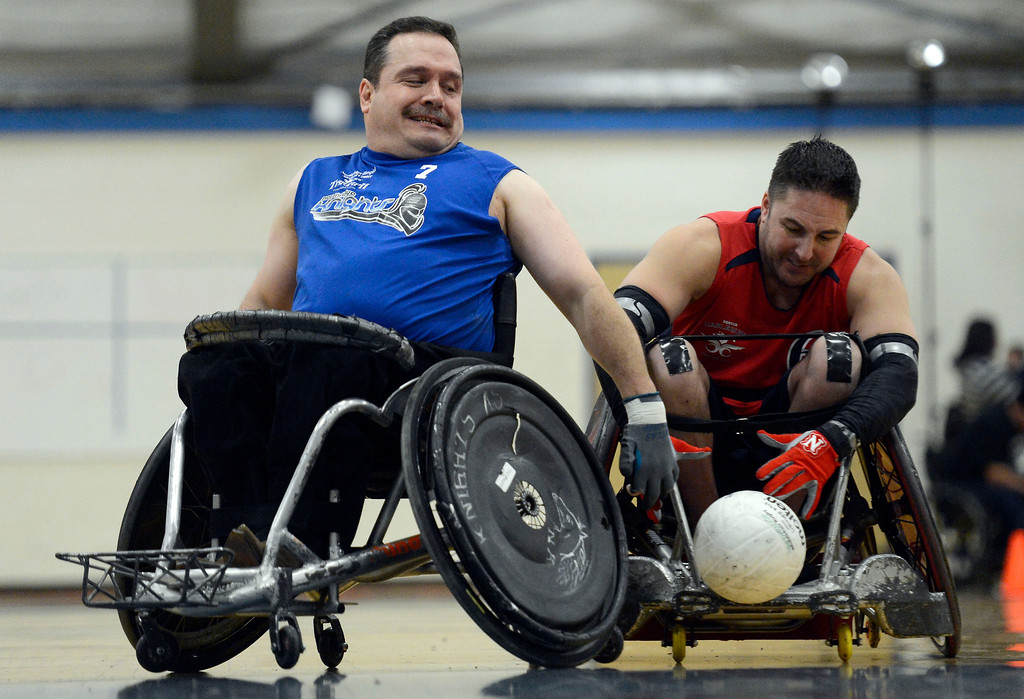. DENVER, CO. - FEBRUARY 10: Jesus Velasco (7) of the Northridge Knights  and Garrett Obsorne (6) of the Denver Harlequins go after a loose ball during the Wheelchair Rugby Tournament February 10, 2013 at Englewood High School.  The Mile High Mayhem was put on by Craig Hospital and city of Englewood.(Photo By John Leyba/The Denver Post)