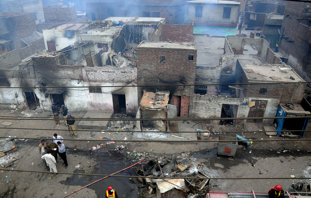 . Pakistani police officials examine the burnt out houses of members of the Christian community attacked by Muslim demonstrators during a protest over alleged blasphemous remarks by a Christian in a Christian neighborhood in Badami Bagh area of Lahore on March 9, 2013. Thousands of angry protestors on March 9 set ablaze more than 100 houses of Pakistani Christians over a blasphemy row in the eastern city of Lahore, officials said. Over 3,000 Muslim protestors turned violent over derogatory remarks allegedly made by a young Christian, Sawan Masih, 28 against Prophet Muhammad in a Christian neighboorhood in Badami Bagh area. Arif Ali/AFP/Getty Images