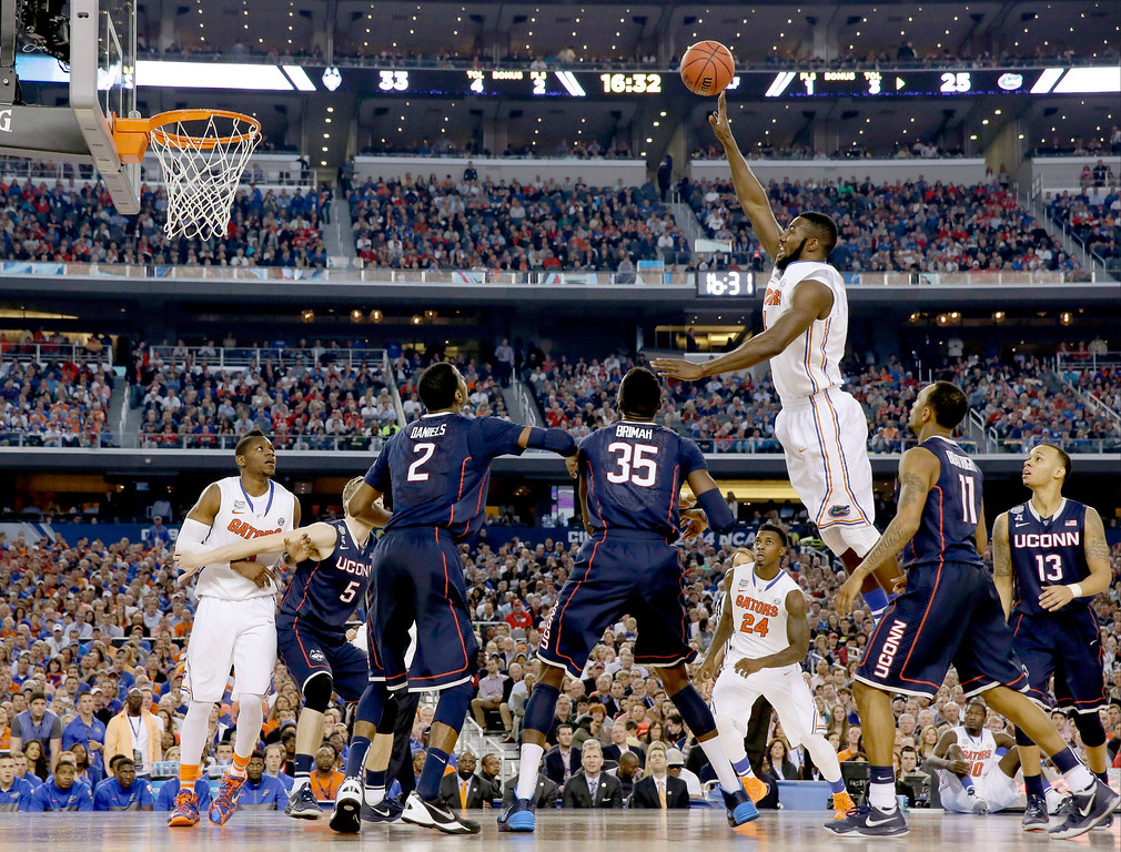 . Florida center Patric Young shoots against Connecticut during the second half of the NCAA Final Four tournament college basketball semifinal game Saturday, April 5, 2014, in Arlington, Texas. (AP Photo/David J. Phillip)