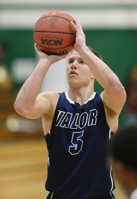 . Eagles\' senior Christian McCaffrey concentrated at the free-throw line. The Valor Christian High School boy\'s basketball team defeated Aurora Central 60-52 Wednesday night, January 8, 2014. Photo By Karl Gehring/The Denver Post