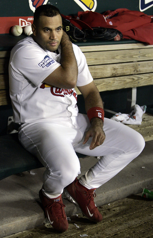 . St. Louis Cardinals\' Albert Pujols sits in the dugout during the inning of Game 4 of the World Series against the Boston Red Sox Wednesday, Oct. 27, 2004, in St. Louis. (AP Photo/Al Behrman)