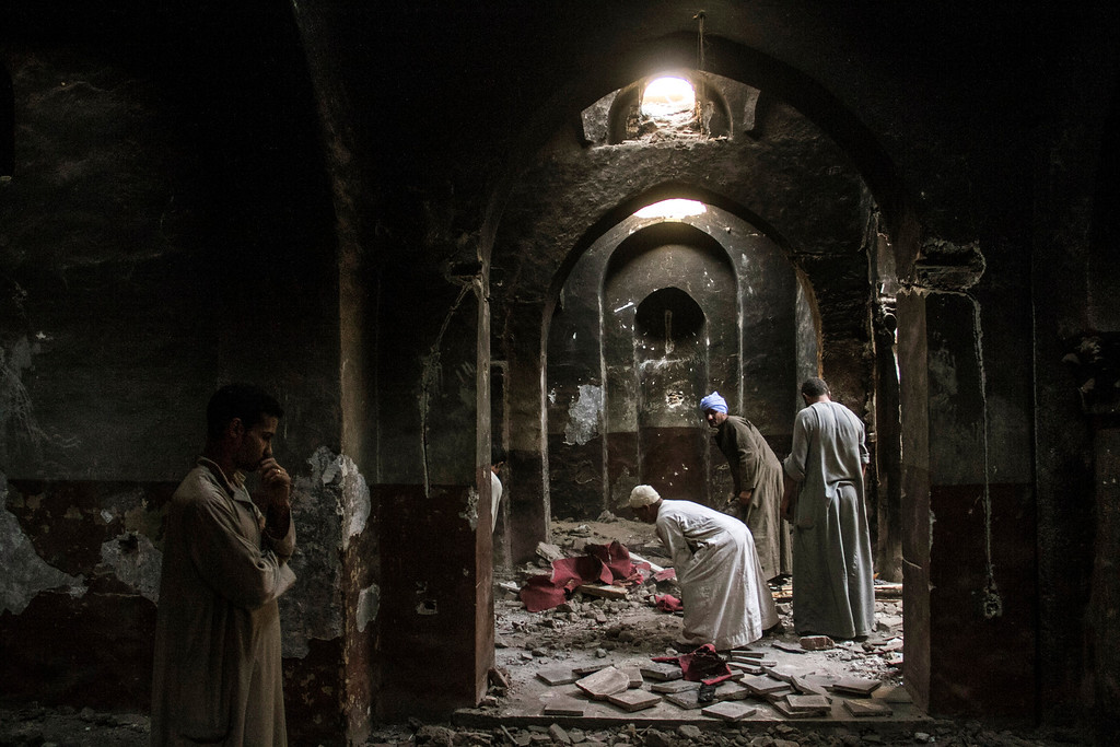 . In this Sept. 3, 2013 photo, Egyptian Christian villagers clean up the damaged ancient chapel inside the Virgin Mary and St. Abraam Monastery that was looted and burned by Islamists, in Dalga, Minya province, Egypt. Dalga has been outside government control since hard-line supporters of the Islamist Mohammed Morsi drove out police and occupied their station on July 3, the day Egypt\'s military chief removed the president in a popularly supported coup. It was part of a wave of attacks in the southern Minya province that targeted Christians, their homes and businesses. (AP Photo/El Shorouk Newspaper, Roger Anis)