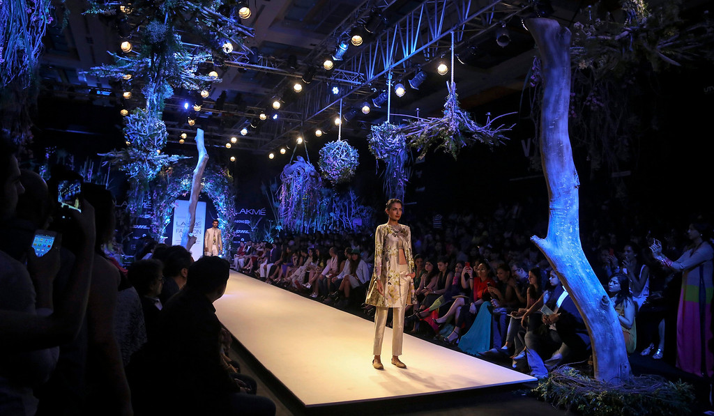 . A model presents a creation by Indian designer Manish Malhotra during an opening show of the Lakme Fashion Week Summer/Resort 2014 in Mumbai, India, 11 March 2014. Some 92 designers will be showcasing their collections at the event running from 12 to 16 March.  EPA/DIVYAKANT SOLANKI