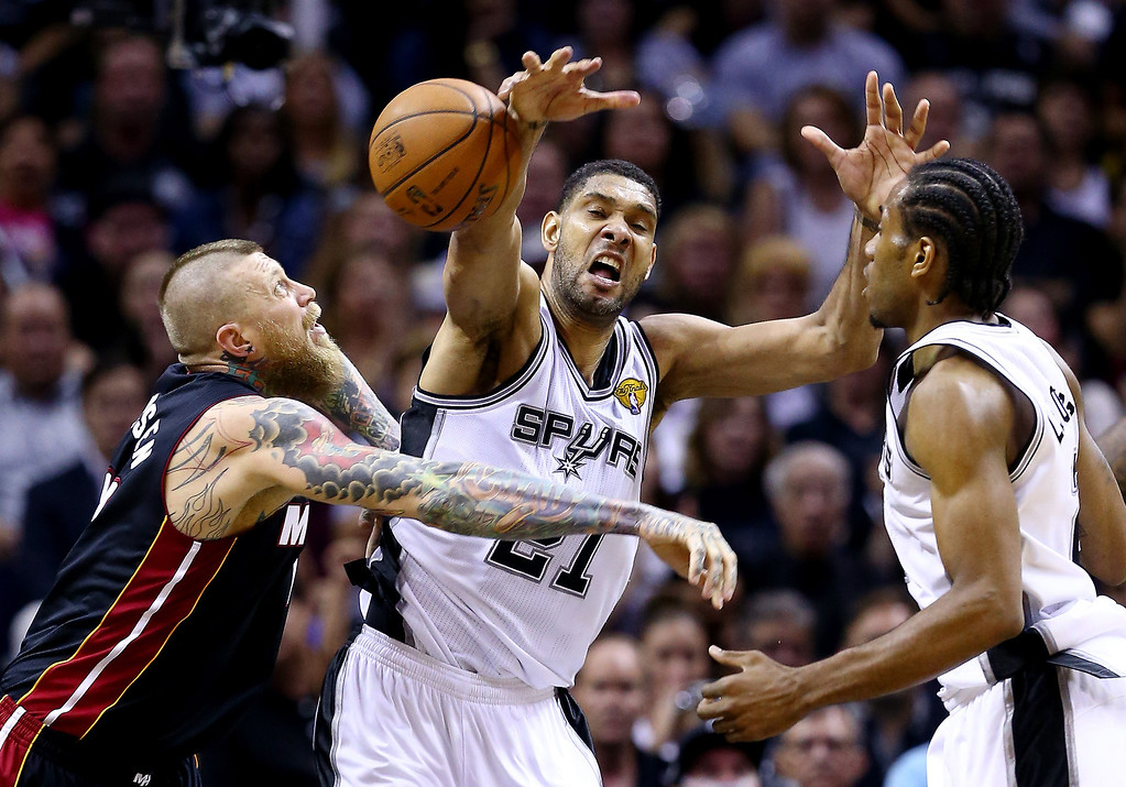 . Tim Duncan #21 of the San Antonio Spurs battles for a rebound against Chris Andersen #11 of the Miami Heat during Game Two of the 2014 NBA Finals at the AT&T Center on June 8, 2014 in San Antonio, Texas.   (Photo by Andy Lyons/Getty Images)
