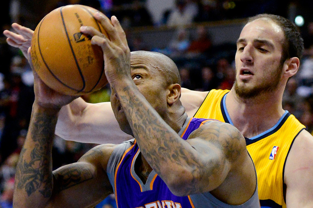 . Kosta Koufos (41) of the Denver Nuggets defends P.J. Tucker (17) of the Phoenix Suns during the first half of action. The Denver Nuggets play the Phoenix Suns at the Pepsi Center. (Photo by AAron Ontiveroz/The Denver Post)