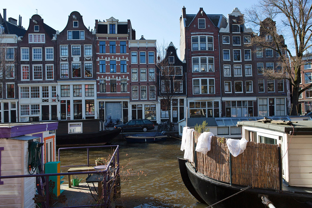 . Laundry hangs from a houseboat at the Prinsengracht canal in Amsterdam April 2, 2013, 2013. The Royal celebrations in the Netherlands this week put the country and the capital Amsterdam on front pages and television screens around the world with an orange splash. There\'s plenty to see and do in 48 hours in this compact city, where the world-famous Rijksmuseum only recently reopened after an extensive renovation. Picture taken April 2, 2013. REUTERS/Michael Kooren