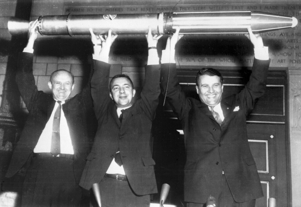 """. William Picketing, James Van Allen, and German scientist Wernher von Braun (from L to R) brandish a model of the first American satellite \""""Explorer 1\"""", 31 January 1958 after the satellite was launched of by a \""""Jupiter C\"""" rocket at Cap Canaveral Space Center. Wernher von Braun\'s team developed the Jupiter-C, a modified Redstone rocket, which successfully launched Explorer 1. This event signaled the birth of America\'s space program. Von Braun, who was pivotal in Germany\'s pre-war rocket development program and was responsible for the design and realization of the V-2 combat rocket during World War II, entered the United States at the end of the war through the then-secret Operation Paperclip. (OFF/AFP/Getty Images)"""