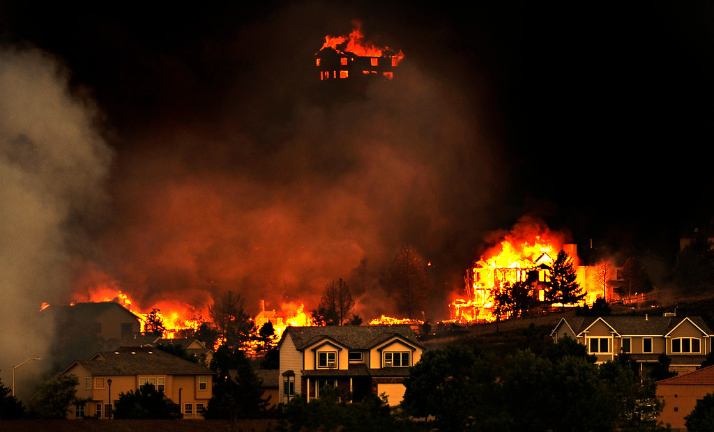 . Waldo Canyon Fire burns out of control, Tuesday, June 26, 2012, in Colorado Springs, Colo.