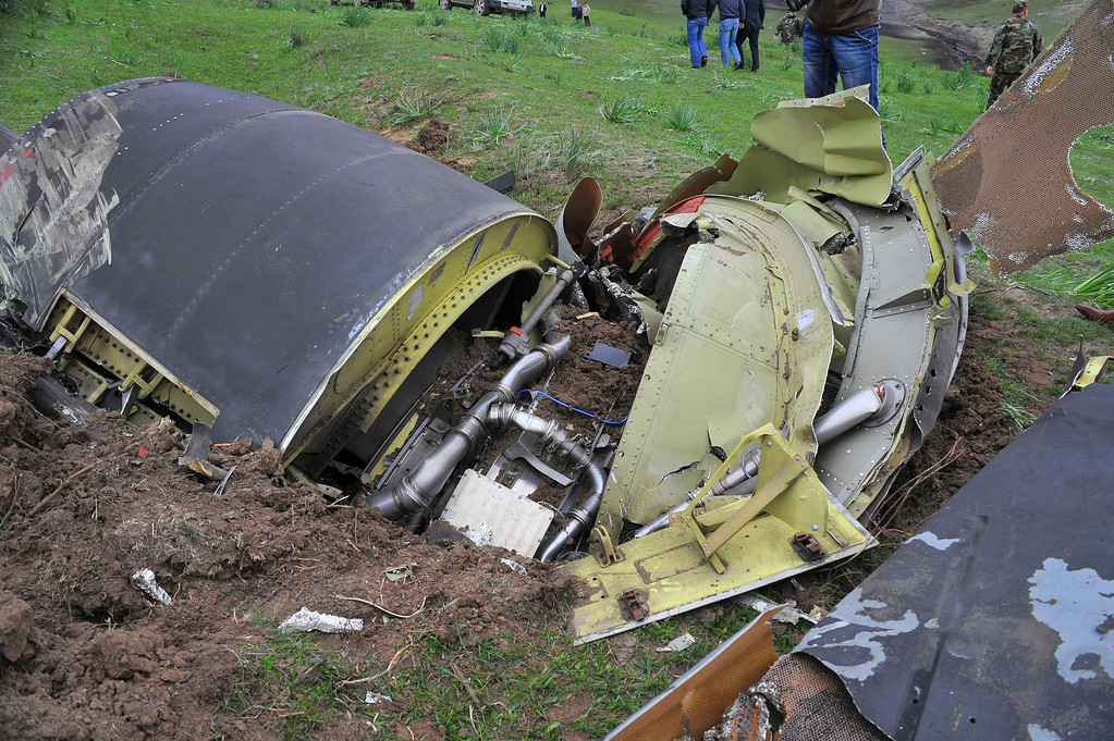 . The wreckage of the Boeing KC-135 Stratotanker plane is seen at the site of its crash near the Kyrgyz village of Chaldovar, May 3, 2013. REUTERS/Sabyr Alichiev/Pool
