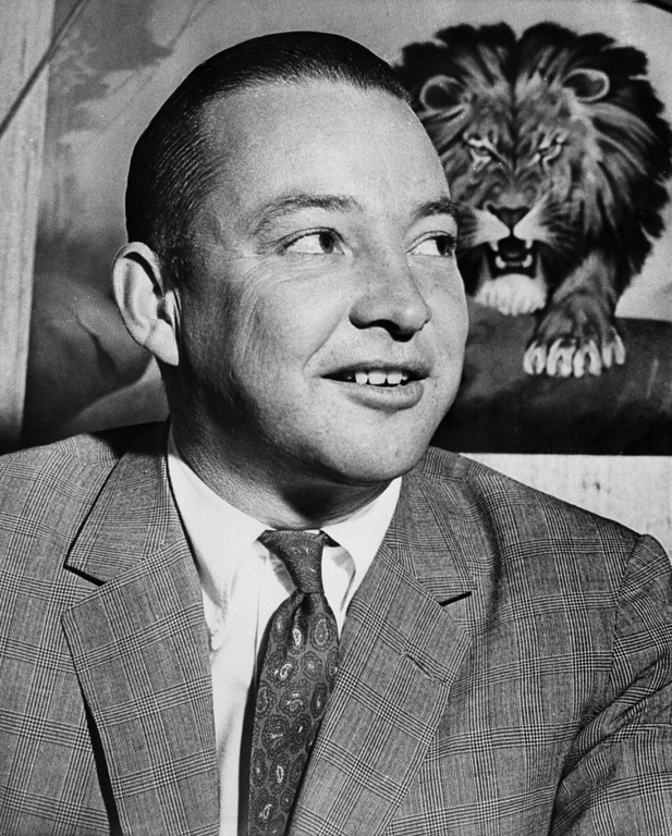 . William Clay Ford poses in front of a lion drawing in the Detroit Lions office after officially taking over as president of the football club, Jan. 24, 1961.  (AP Photo)