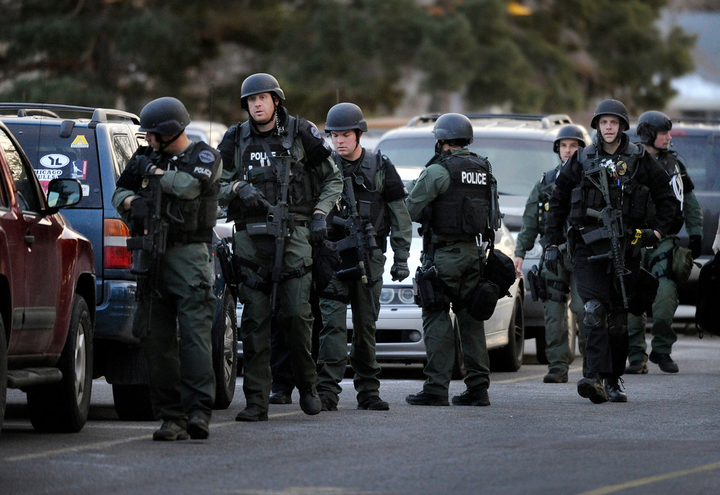 . CENTENNIAL, CO. - DECEMBER 13:Police officers in tactical gear searched the student parking lot of Arapahoe High School Friday afternoon, December 13, 2013. A shooting inside the school sent hundreds of students rushing for safety. (Photo By Karl Gehring/The Denver Post)