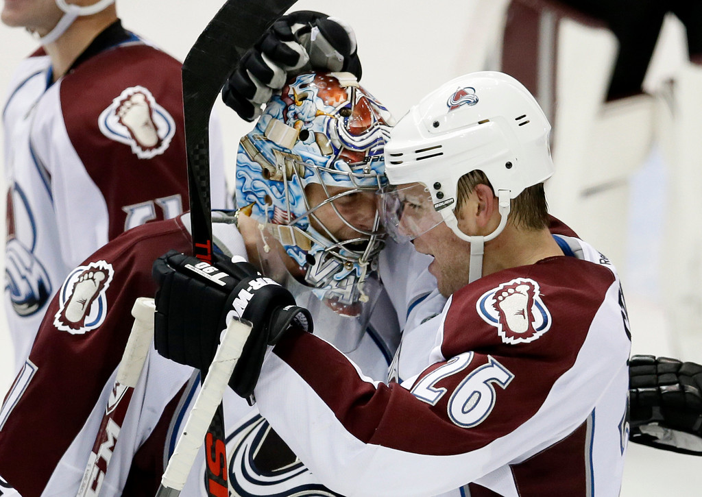 . Colorado Avalanche goalie Semyon Varlamov (1), of Russia, celebrates with Paul Stastny (26) following a goal by Stastny in overtime against the Dallas Stars in an NHL hockey game, Friday, Nov. 1, 2013, in Dallas. The Avalanche won 3-2. (AP Photo/Tony Gutierrez)