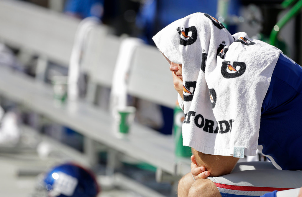 . New York Giants\' Josh Brown sits alone on the bench during the second half of an NFL football game against the Carolina Panthers in Charlotte, N.C., Sunday, Sept. 22, 2013. The Panthers won 38-0. (AP Photo/Bob Leverone)