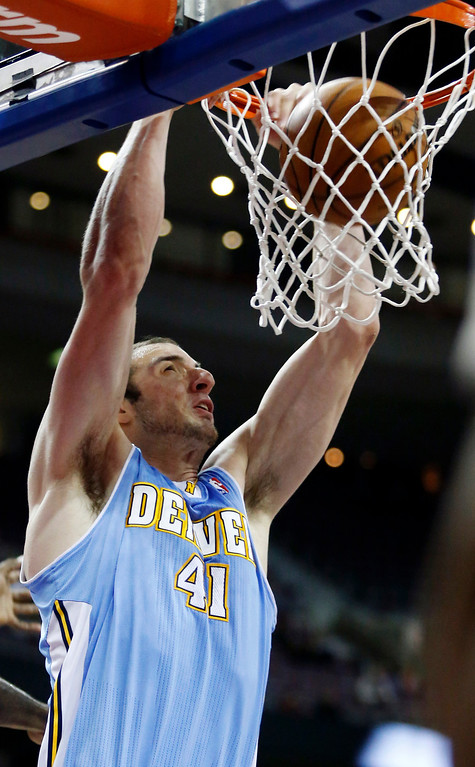. Denver Nuggets center Kosta Koufos (41) dunks against the Detroit Pistons in the second half of an NBA basketball game, Tuesday, Dec. 11, 2012, in Auburn Hills, Mich. The Nuggets won 101-94. (AP Photo/Duane Burleson)