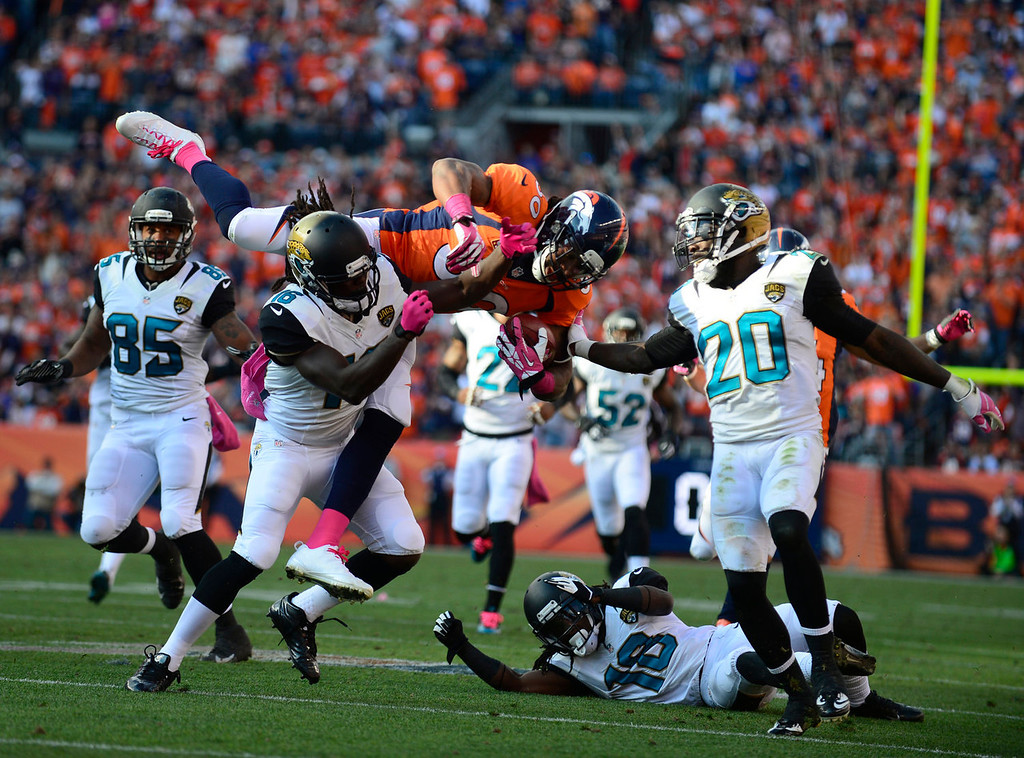 . Denver Broncos strong safety David Bruton (30) gets hit after the Broncos faked a punt in the third quarter. The Denver Broncos take on the Jacksonville Jaguars at Sports Authority Field at Mile High in Denver on October 13, 2013. (Photo by AAron Ontiveroz/The Denver Post)