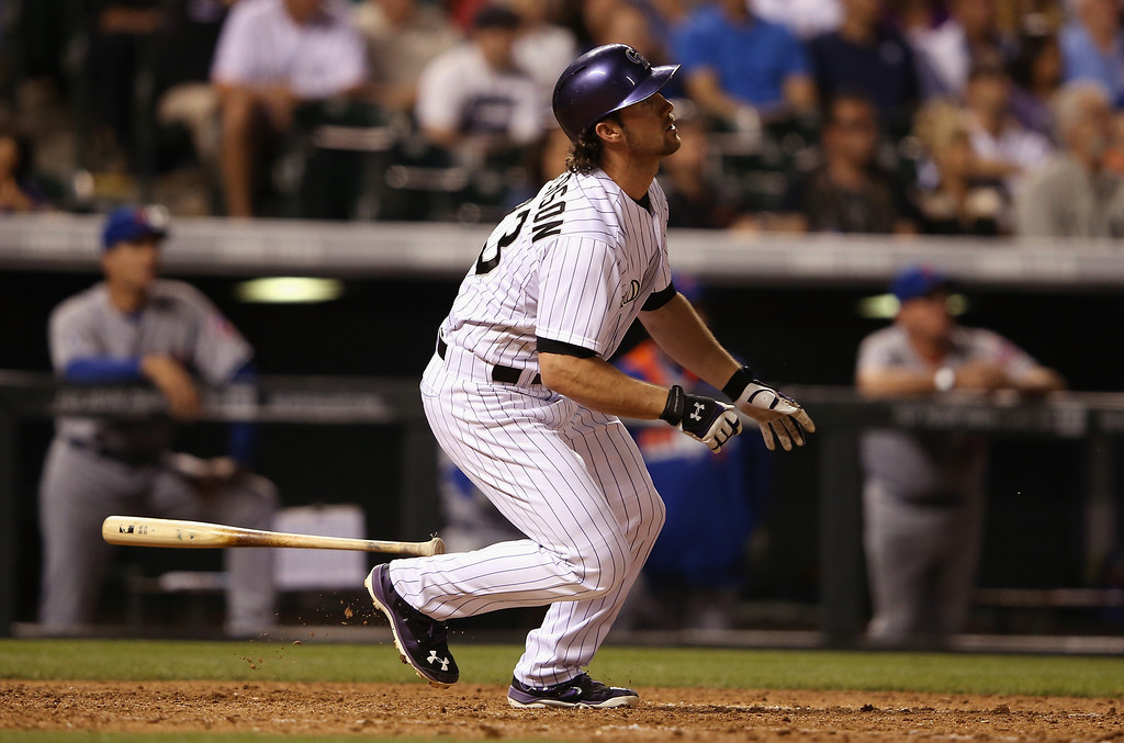 . DENVER, CO - MAY 03:  Charlie Culberson #23 of the Colorado Rockies watches his game winning walk off two run pinch hit home run off of Kyle Farnsworth #44 of the New York Mets at Coors Field on May 3, 2014 in Denver, Colorado. The Rockies defeated the Mets 11-10.  (Photo by Doug Pensinger/Getty Images)