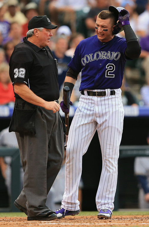 . DENVER, CO - JULY 27:  Troy Tulowitzki #2 of the Colorado Rockies discusses a called third strike with homeplate umpire Dana DeMuth that ended the first inning against the Milwaukee Brewers at Coors Field on July 27, 2013 in Denver, Colorado.  (Photo by Doug Pensinger/Getty Images)