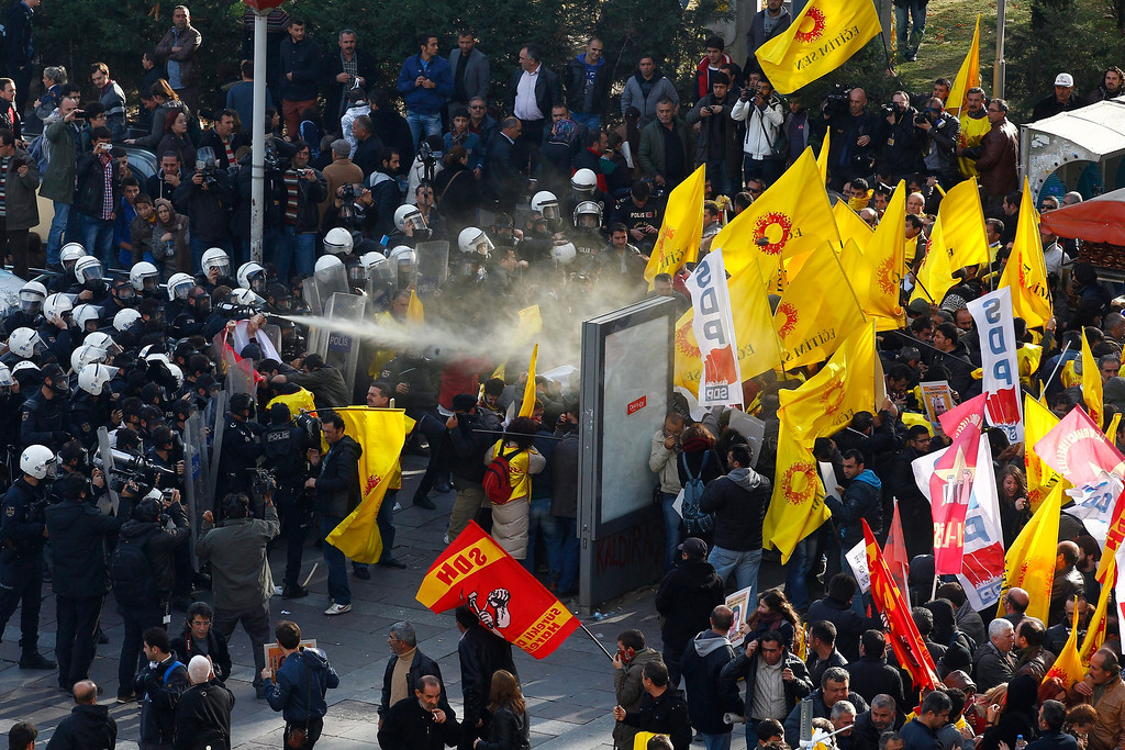 . Turkish riot police use a water jet to disperse protesting teachers during an anti government rally in Ankara, Turkey 23 November 2013.  EPA/CEM OKSUZ ANADOLU AGENCY