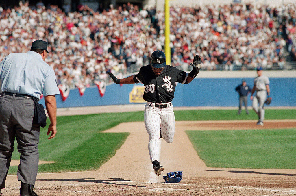 . TIM RAINES -- Tim Raines scores the only Chicago White Sox run on a wild pitch by Toronto Blue Jays pitcher Dave Stewart in the first inning of Game 2 of the American League Championship Series on  Oct. 6, 1993 in Chicago\'s Comiskey Park.   (AP Photo/ John Swart)