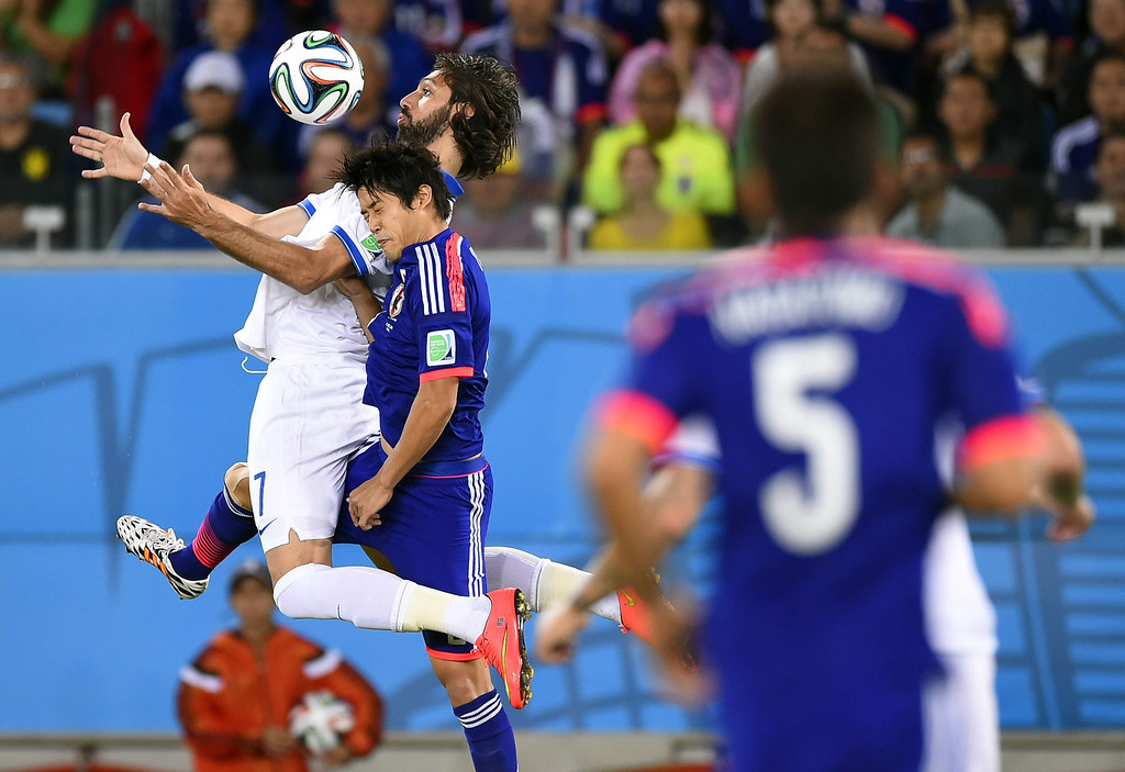. Greece\'s forward Georgios Samaras (L) vies with Japan\'s defender Atsuto Uchida (R) during a Group C football match between Japan and Greece at the Dunas Arena in Natal during the 2014 FIFA World Cup on June 19, 2014.  IFABRICE COFFRINI/AFP/Getty Images