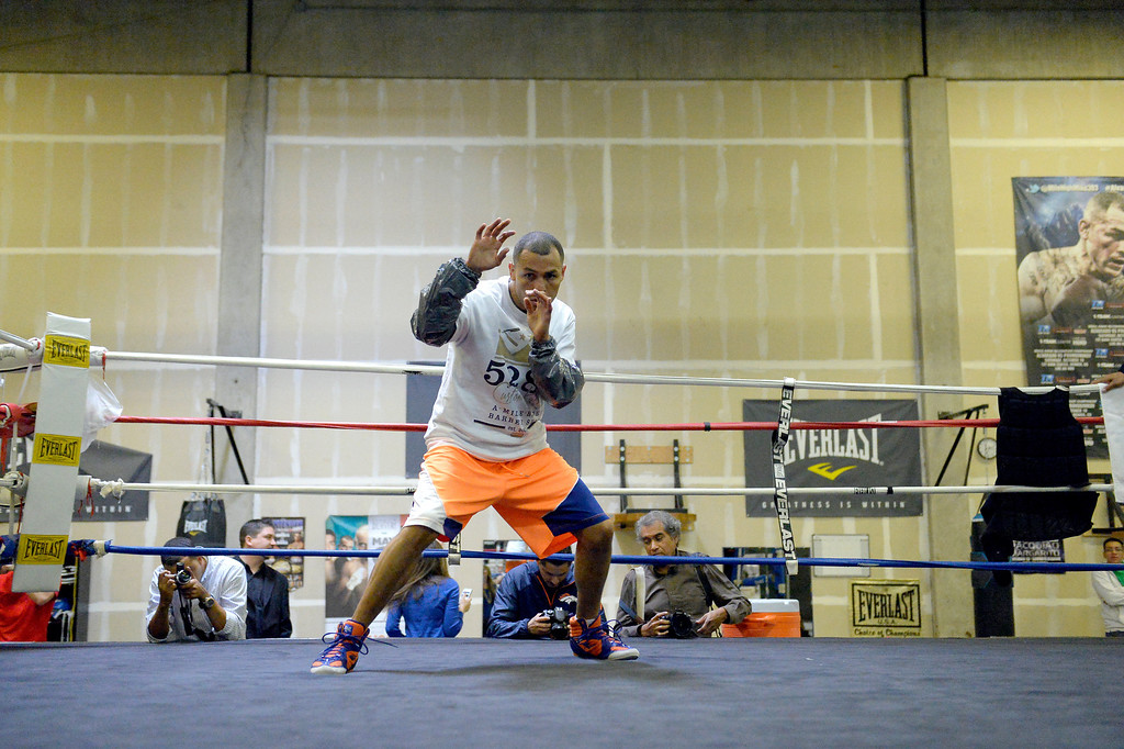 """. DENVER, CO - OCTOBER 15: Colorado\'s only reigning Champion \""""Mile High\"""" Mike Alvarado held a media workout day at Delgado\'s Gym October 15, 2013 as he gets ready for his fight with the Russian Provodnikov at 1st Bank Center. (Photo by John Leyba/The Denver Post)"""