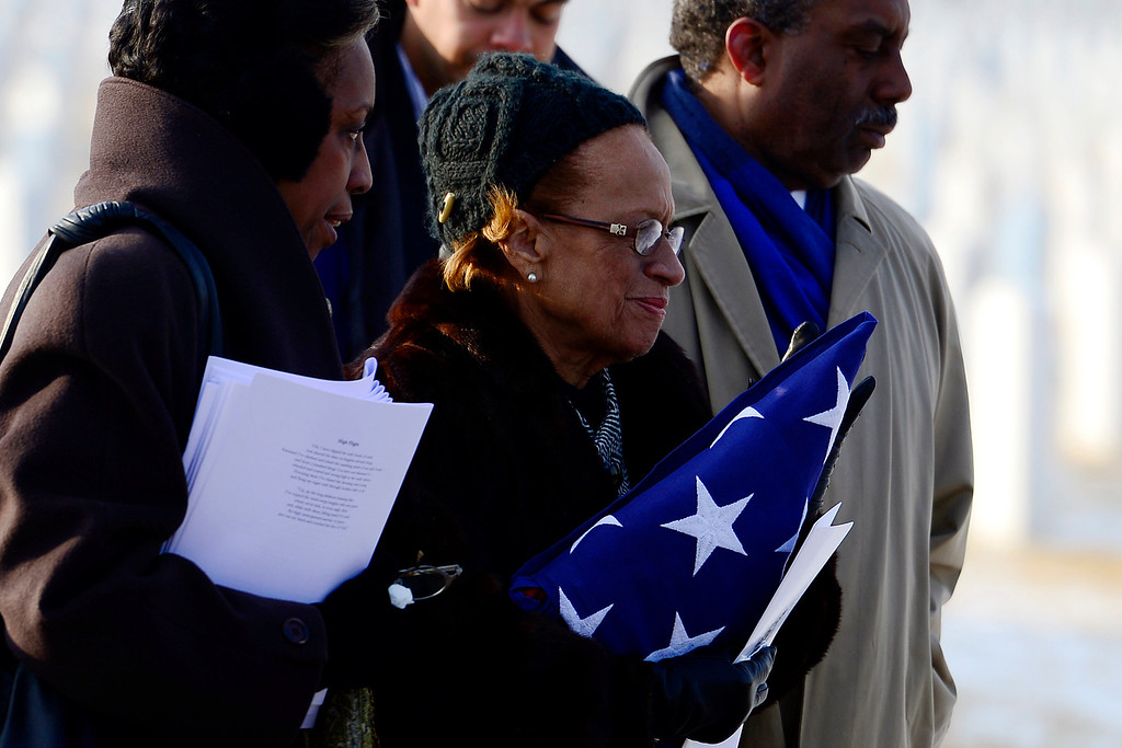 . The family of Colonel Fitzroy Newsum, from left, Dani Schoemberg (daughter), Joan Newsum (wife) and Eric Newsum (son) during his funeral service at Fort Logan National Cemetery on Monday, January 14, 2013. Newsum, who was 94, served as a Tuskegee Airman during his military service. AAron Ontiveroz, The Denver Post