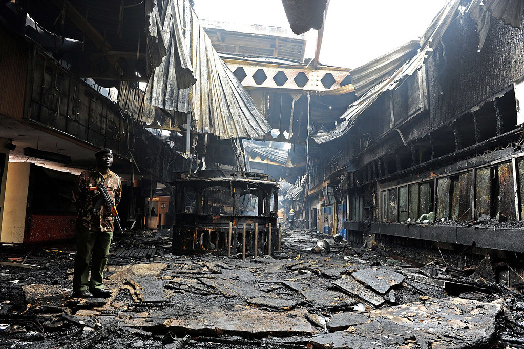 . A soldier stands among the debris after a fire damaged a terminal at the Jomo Kenyatta international airport in Nairobi on August 7, 2013.  AFP PHOTO /StringerSTRINGER/AFP/Getty Images