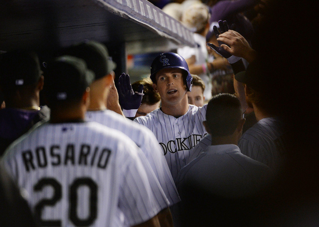 . DENVER JUNE 06: Drew Stubbs of Colorado Rockies (13) celebrates his home run from Hyun-Jin Ryu of Los Angeles Dodgers in the 6th inning of the game at Coors Field in Denver, Colorado June 6, 2014. (Photo by Hyoung Chang/The Denver Post)